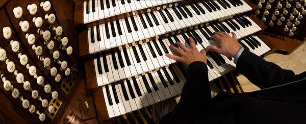 A close up shot of the pedals of an organ.