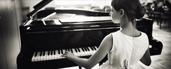 An old photo of me playing the piano.